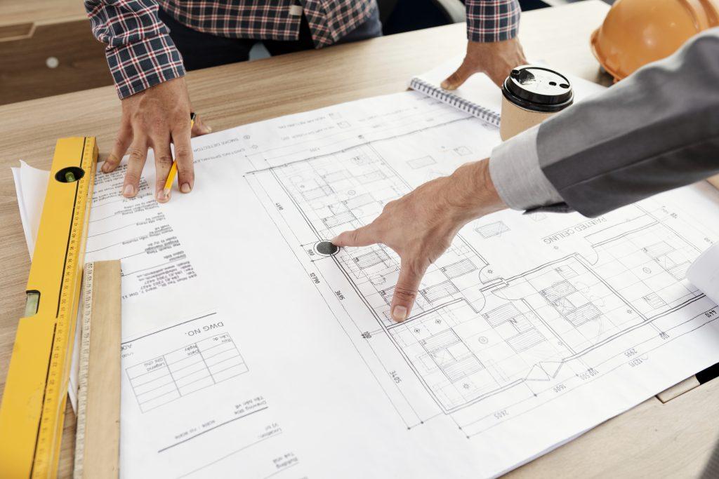photodune EE1ZyLZJ people examining construction blueprint xxl